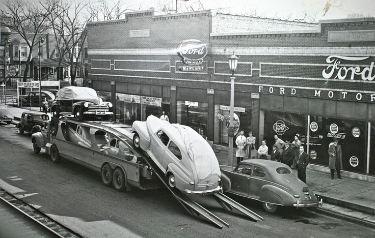 Ford dealer taking delivery of new cars in 1940's